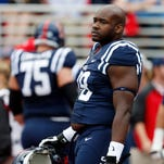 Ole Miss offensive lineman Laremy Tunsil (78) looks around during pre-game warmups prior to an NCAA college football game against Louisiana-Lafayette at Vaught-Hemingway Stadium in Oxford, Miss., Saturday, Sept. 13, 2014. (AP Photo/Rogelio V. Solis)