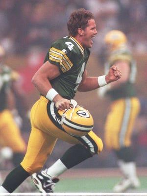 Brett Favre celebrates a touchdown pass to Antonio Freeman in Super Bowl XXXI.