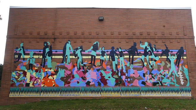 This mural, on the north side of the Martin Luther King Jr. Center,  312 Chestnut St., was painted by 50 west bayfront children enrolled in the center's after-school and summer programs. The mural, whose creation was supervised by Erie artists Ed Grout and Tom Ferraro, marks a stop in the West Bayfront Mural Walk, one of a series of neighborhood walks that the Our West Bayfront group organized.