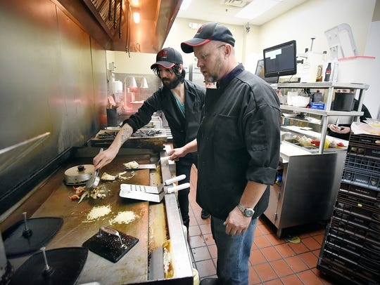 Axle Grill cook Matt Naples and owner Tony Sykora work