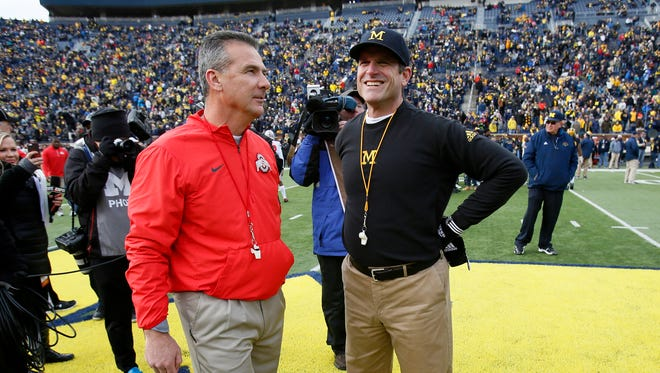 Urban Meyer, left, and Jim Harbaugh.
