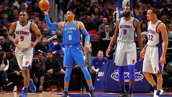 Oklahoma City Thunder guard Russell Westbrook (0) tosses the ball to a referee during the first quarter in betwen Detroit Pistons center Andre Drummond (0) guard Avery Bradley (22) an guard Langston Galloway (9) at Little Caesars Arena.