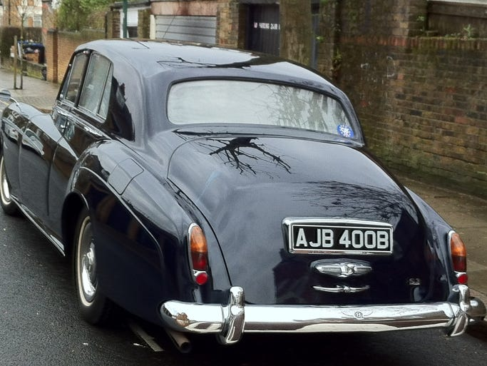 Bentley bought new in 1964 by Beatles manager Brian Epstein still has its original license plate, according to Coys auction house which hopes to get $115,000 for it at a sale March 11 in London.