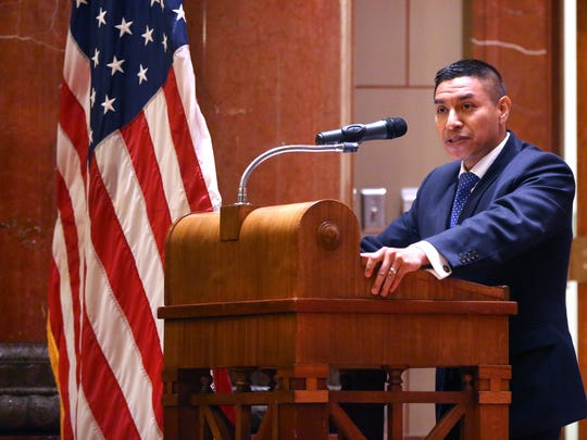 Diego Morales, shown in a 2015 IndyStar file photo speaking to new American citizens after they were sworn in, is running for Rep. Todd Rokita's congressional seat, in part on a promise to tighten border security.