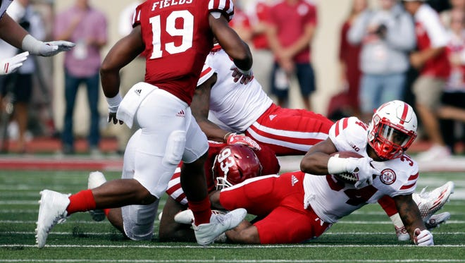 Nebraska Cornhuskers running back Terrell Newby (34) is tackled by Indiana Hoosiers defensive lineman Ralph Green III (93) during the first half of the game at Memorial Stadium.
