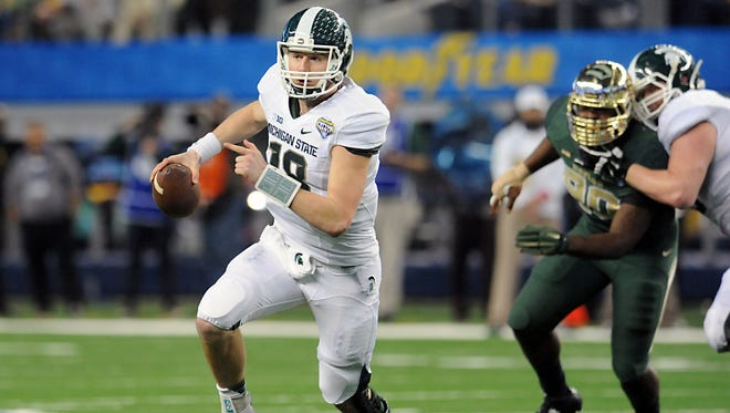 MSU quarterback Connor Cook takes off on a key first down run late in  MSU's come-from-behind  42-41 victory over Baylor in the Cotton Bowl.