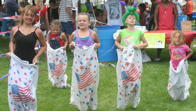 A group of girls competes in a sack race at the 2013 Fernley 4th of July celebration at the Out-of-Town Park.