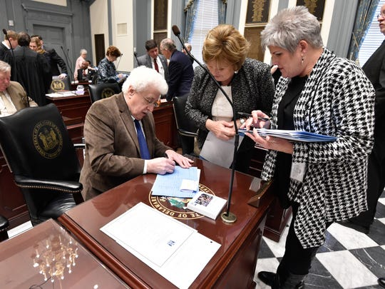 State Rep. John Kowalko Jr., D-Newark South, signs documents before the start of the 149th General Assembly at Legislative Hall in Dover on Tuesday.
