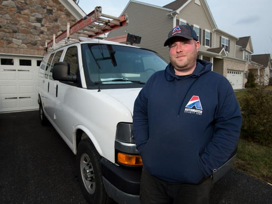 Middletown resident Brian Wyre stands with his work van, which he regularly drives to his Lancaster, Pennsylvania, and New Jersey. He moved to the area for quality of life and gained a long-distance commute.