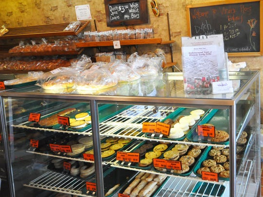 The Vander Ploeg Bakery in Pella, Iowa, sits just a few doors down from Jaarsma Bakery on the town square.