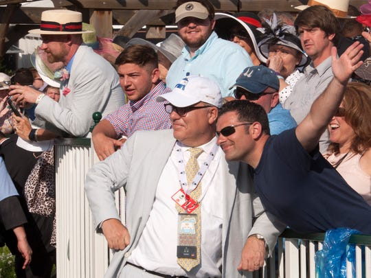 Mike Stanfield poses with Jeff Tislow in the paddock at Churchill Downs on Kentucky Derby day.