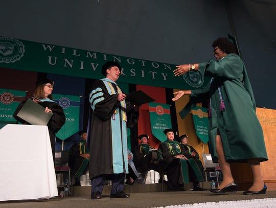 Jack Varsalona, Ed.D., President hands out diplomas