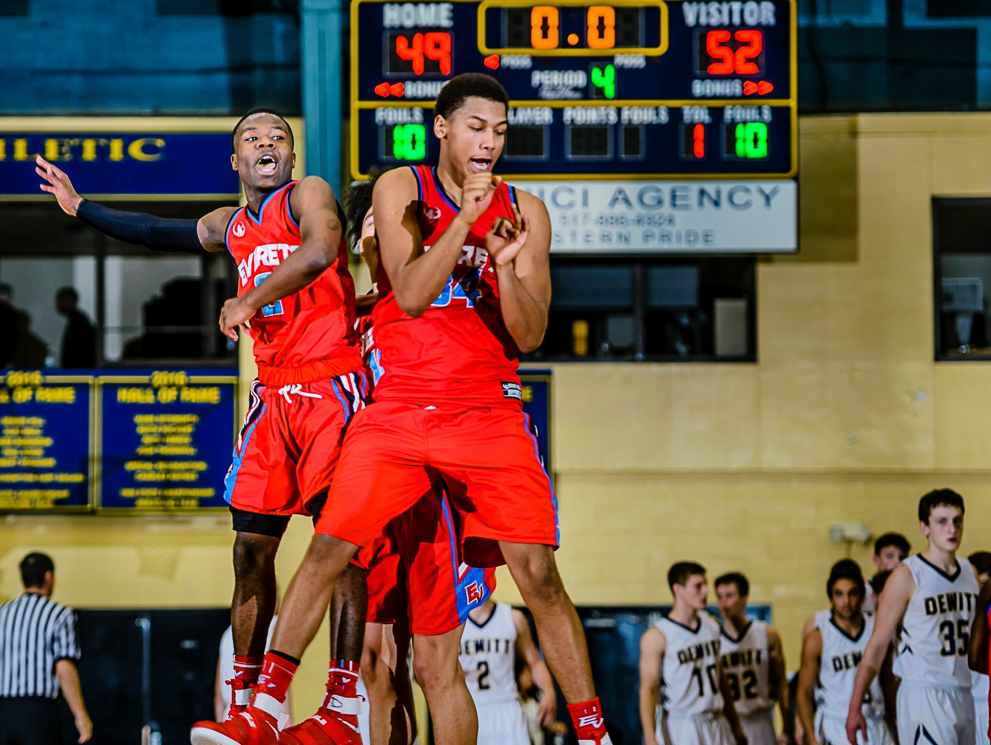 Nyreel Powell ,left, of Everett and teammate Diego Robinson celebrate after their Class A district semifinal win over DeWitt Wednesday March 8, 2017 at Don Johnson Fieldhouse in Lansing.