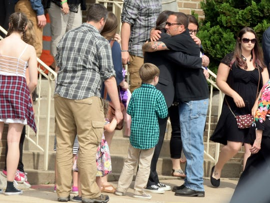 Two men hug outside Otterbein United Methodist Church