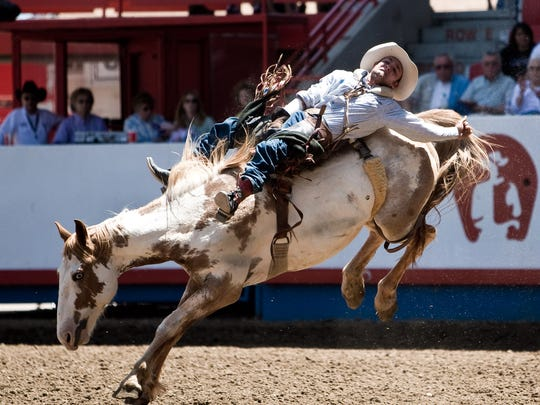 The bareback bronc riding competition is one of many rodeo events at the Greeley Stampede. Will Lowe rides South Plains in the bareback bronc riding competition at the Greeley Stampede.