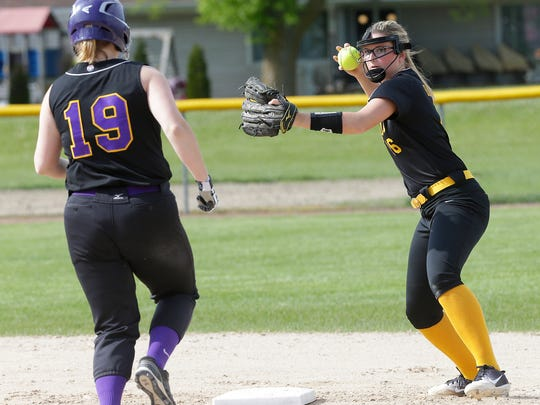 Waupun High School softball's Claire Harder throws