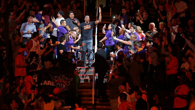 Phoenix Suns guard Eric Bledsoe is introduced during the season opener against the Dallas Mavericks during an NBA game on Oct. 28, 2015, in Phoenix.