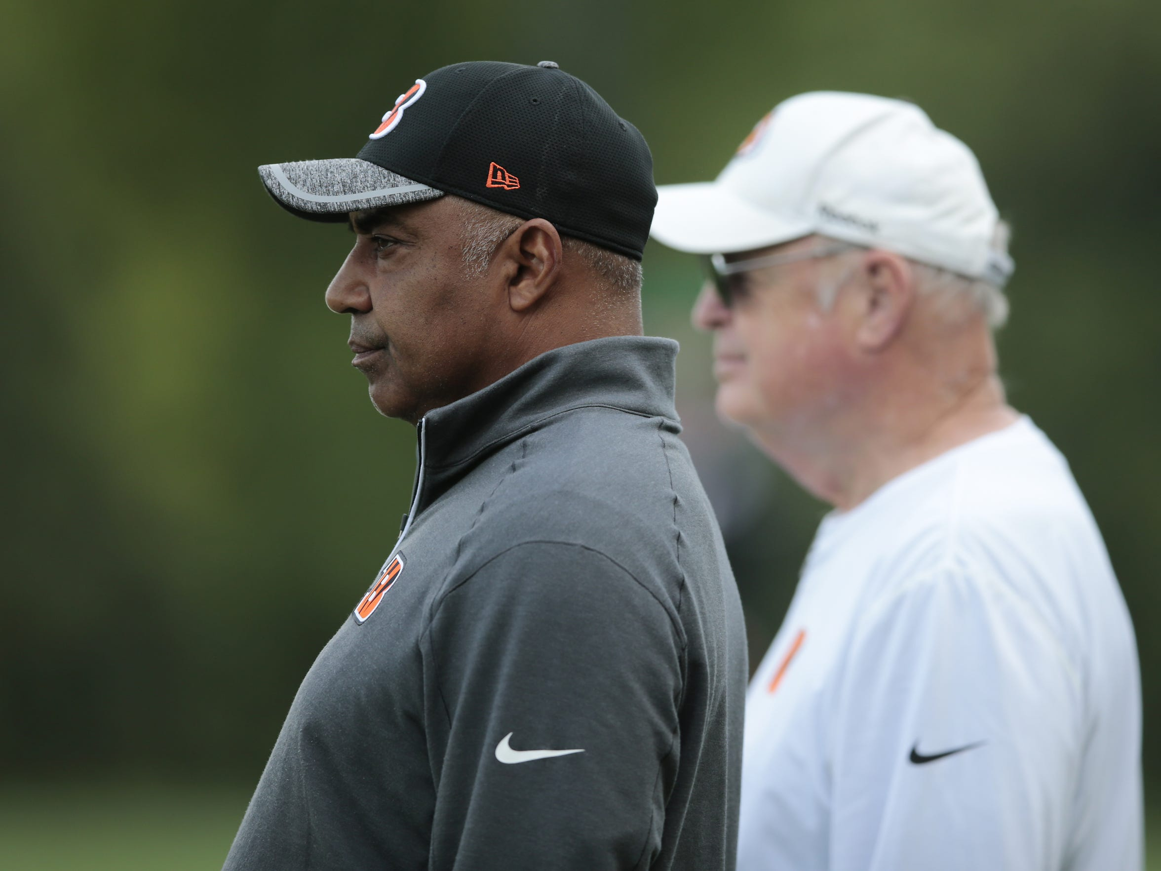 Cincinnati Bengals head coach Marvin Lewis, left, and team president Mike Brown, right, look on during Cincinnati Bengals rookie mini camp, Friday, May 6, 2016, on the practice fields adjacent to Paul Brown Stadium in Cincinnati.