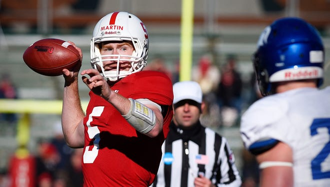 St. John's University quarterback Nick Martin sets up to throw against Dubuque during the first half Saturday, Nov. 21, at Clemens Stadium.