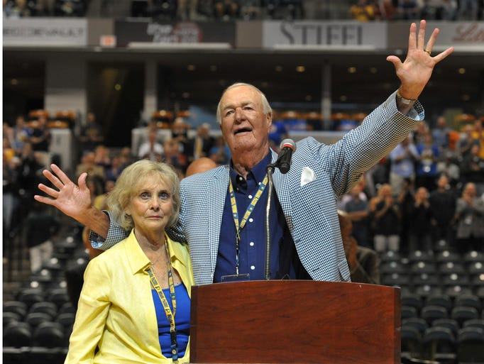 "Bobby ""Slick"" Leonard and wife Nancy, acknowledge applause from the crowd as he spoke before the viewing of the documentary ""Heart of a Hoosier"" at Bankers Life Fieldhouse Tuesday July 29, 2014."