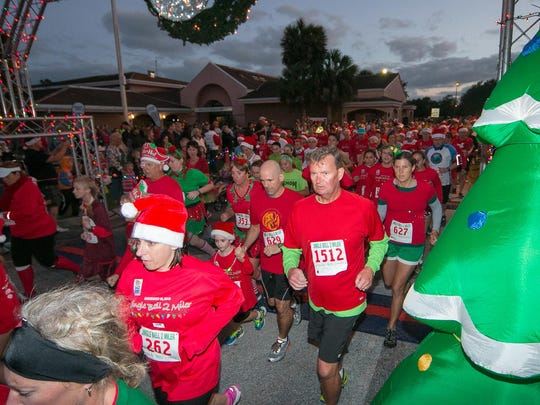 Participants make their way through the start of the 2015 Jingle Bell 2-Miler in Satellite Beach.