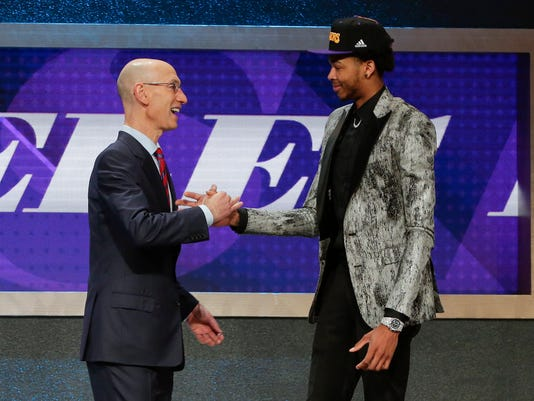 NBA Commissioner Adam Silver greets Brandon Ingram after Ingram was selected as the second pick overall by the Los Angeles Lakers during the NBA basketball draft, Thursday, June 23, 2016, in New York. (AP Photo/Frank Franklin II)