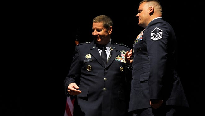 Retired Master Sgt. Kristopher Parker (right) is awarded the Silver Star by Gen. Robin Rand (left), Commander of Air Force Global Strike Command during a ceremony on Friday, March 17, 2017, at Dyess Air Force Base.