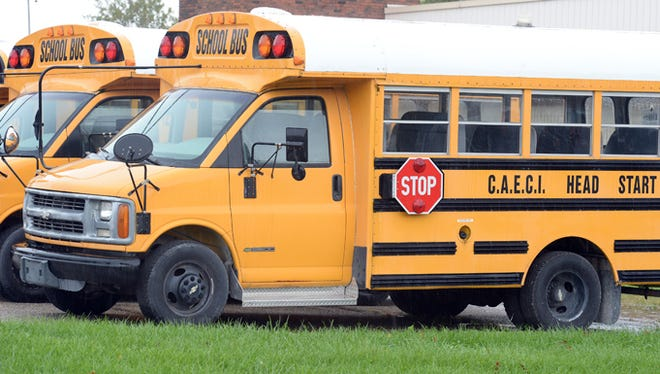 Community Action of East Central Indiana, Inc. school bus in the parking lot at 1845 West Main Street in Richmond.