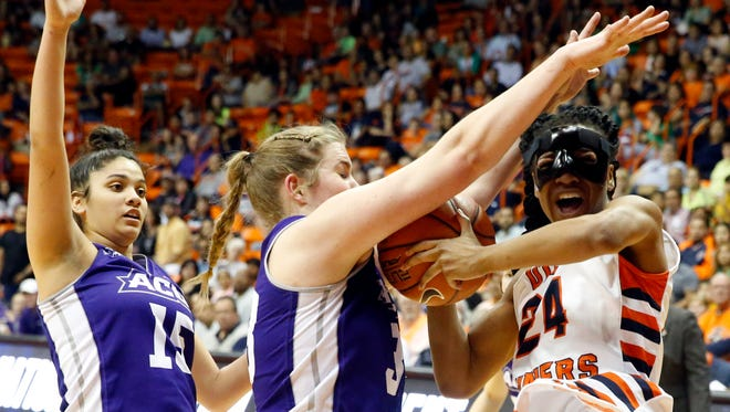 UTEP guard Jenzel Nash drives to the basket against the defensive pressure being applied by Abilene Christian's Sydney Shelstead and Alexis Mason (15) during the fourth quarter of action at the Don Haskins Center in the first round WNIT game Thursday night at the Don Haskins Center. UTEP came away with the win, 66-62, and will play Arkansas State on Monday night. See more photos at elpasotimes.com.