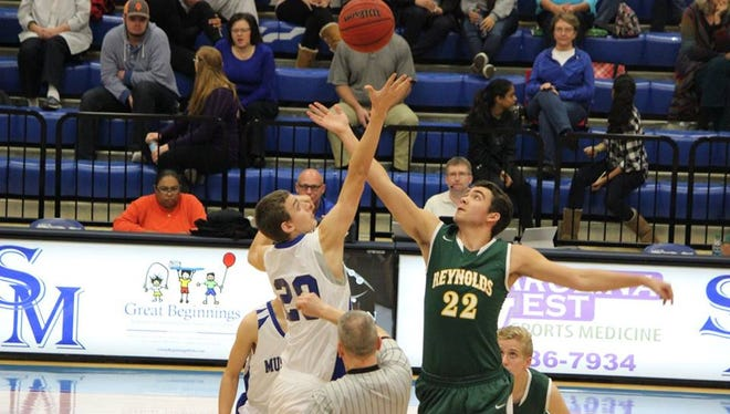 Max Hurst (22) tries to control a tip-off for the Reynolds boys during a game this season at Smoky Mountain.