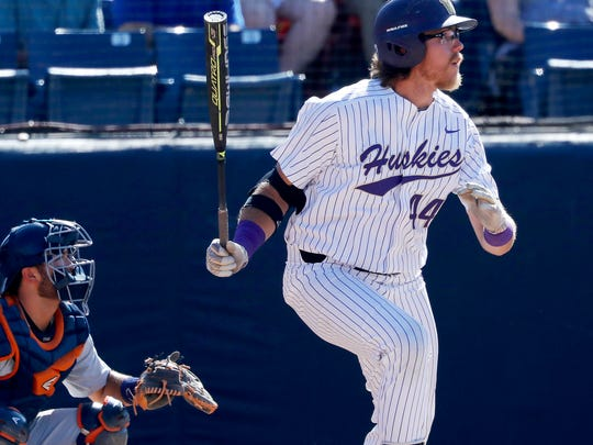 Washington's Joe Wainhouse watches his solo home run against against Cal State Fullerton during the fourth inning of an NCAA college baseball tournament super regional game Saturday, June 9, 2018, at Goodwin Field in Fullerton, Calif.