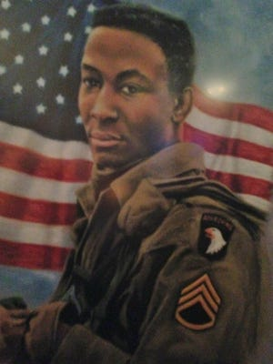 A painting of posthumous Medal of Honor recipient Staff Sgt. Clifford Sims, Co. D, 501st Infantry, made after his death, depicting the Screaming Eagle patch of the 101st Airborne Division, as requested by his widow. The original photo displayed an 82nd Airborne patch.