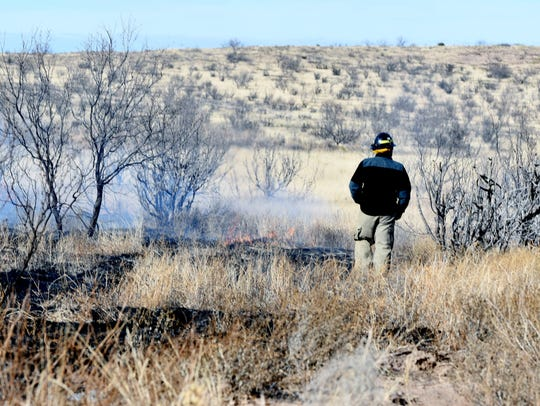A prescribed burn official monitors the low and slow