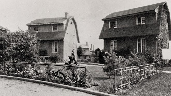 Two of the houses in the Concrest Development in East Rochester are seen in this circa 1930 photo.