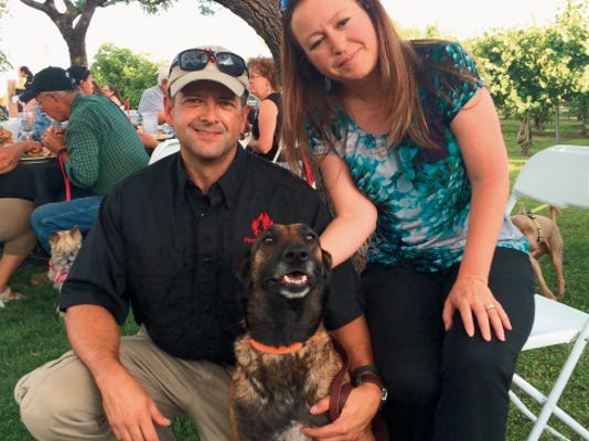 Greg Whited and his wife, Crystal David-Whited, both of FireTrackers LLC, with Brisa, their accelerant detection canine.