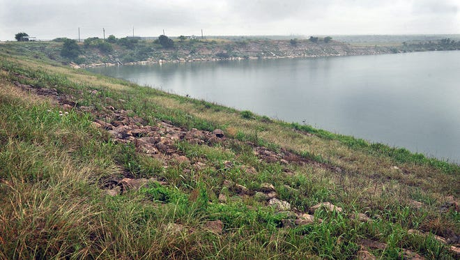 The northeast end of Lake Kemp shows the lake level well up to the dam and readings show the lake is full at a 1,144-foot elevation in this May 2016 photo. Legislation passed by Congress prevents the Corps of Engineers from forcing the city of Wichita Falls to demolish lake cabins below 1,159 feet mean sea level until 2025.