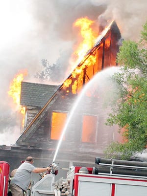 Firefighters from several departments across the county brought equipment to fight the blaze.
