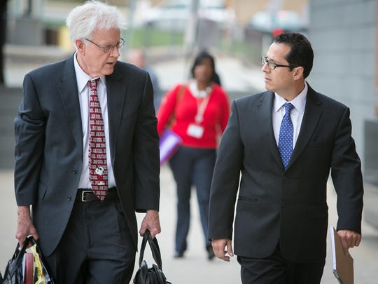 Gabriel F. Pardo (right), 45, of Hockessin arrives with his lawyer Joe Hurley at the New Castle County Courthouse in September.