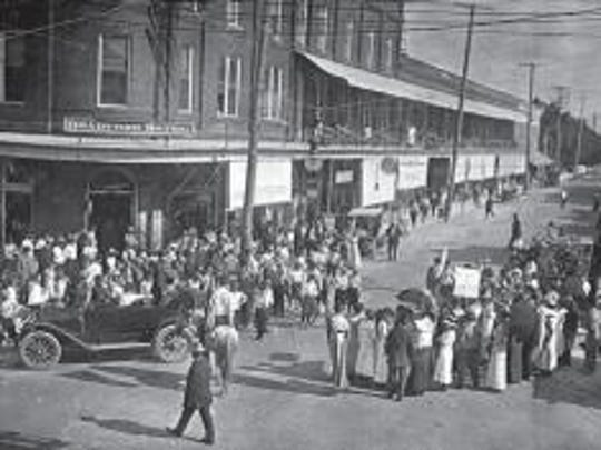 A parade was held for the opening of the Gwynne Institute in 1911. The school's construction and furnishing cost $45,000 (well over $1 million today).