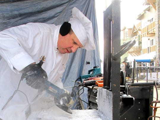 Ice sculptor Rich Bubin of Pittsburgh, Penn., stirs