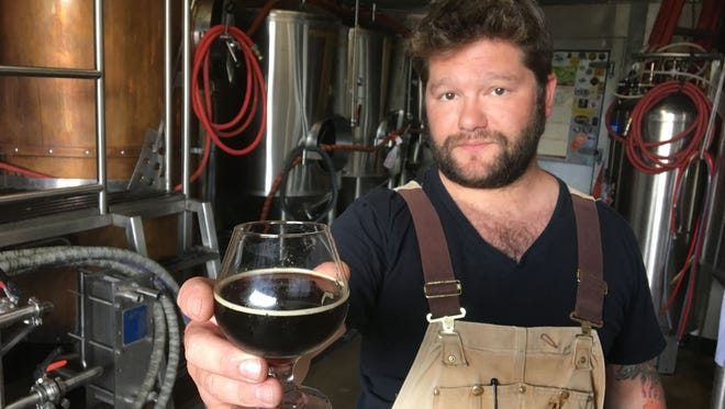 Nicholas Joseph, 33, holds a glass May 25, 2016 of his Ninja Pirate, a barleywine he brewed at Black Lotus Brewing Co. that won a gold medal in the 2016 World Beer Cup competition.