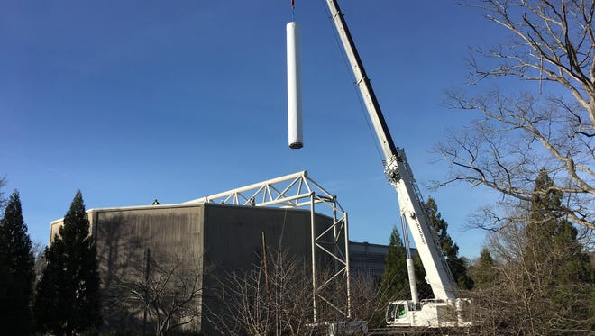 A crane lifts a panoramic painting depicting the Battle of Atlanta from the American Civil War at Grant Park in Atlanta on Friday, Feb. 10, 2017. Moving the 6-ton Cyclorama  one of the world's largest paintings  from the park to the Atlanta History Center across town marks a major milestone in its restoration, historians said. (AP Photo/Alex Sanz) ORG XMIT: RPAS102