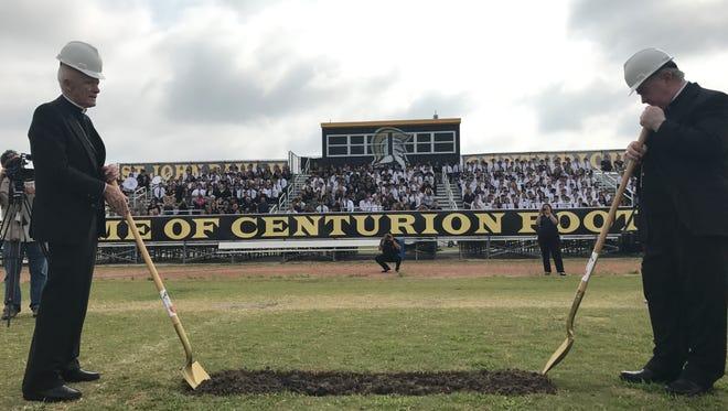 Bishop Emiritus Edmond Carmody (left) and Bishop Michael Mulvey break ground May 12, 2017 on the new Bishop Carmody Football Field at St. John Paul II High School