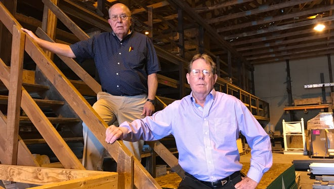Eric Doll, left, and Morrie Smith, owners of Hazen Lumber in Lansing, are retiring and closing the business after 77 years in operation.