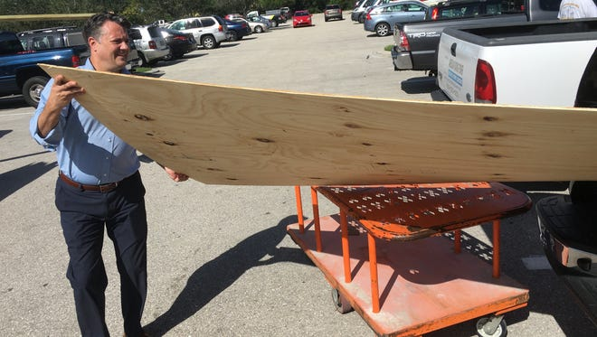 David Lang of Fort Myers loads wood into his vehicle Tuesday morning at The Home Depot store in south Fort Myers.