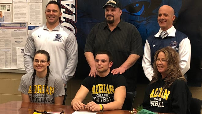 Lakota's Tyler Gabel will continue his career at Adrian College. He is joined by Raiders coach Mike Lento, father Ryan Gabel, Lakota athletic director Kevin Yeckley, sister Alexa Gabel and mother, Connie Gabel.
