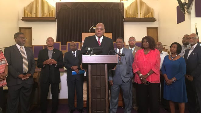 Rev. R. B. Holmes and other faith and community leaders decry the Trump administration policy of separating immigrant families at the U.S. border and call on community members to speak up.
