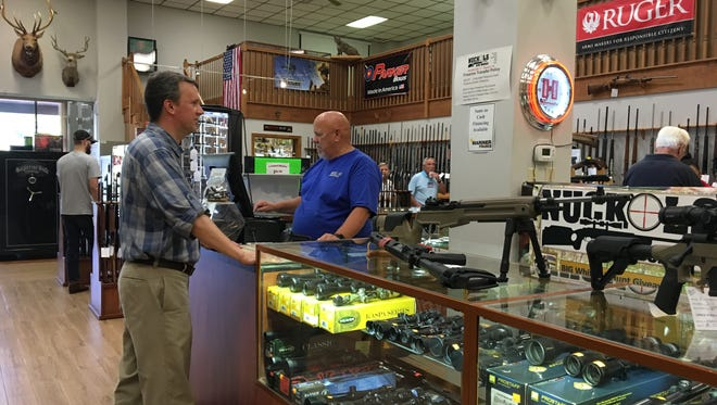 "Ben Cline talks to an employee at Nuckols Gun Works during his ""Summer of the Walk"" tour in Staunton."