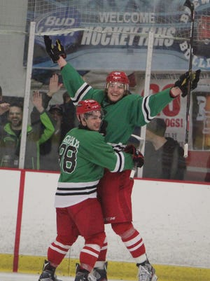 Brewster's Jan Salak (right) celebrates with MJ Graham after scoring a powerplay goal in the third period during a Federal Hockey League game at the Brewster Ice Arena on Thursday, March 17th, 2016. Brewster won 4-2.