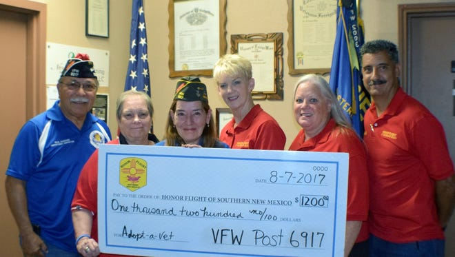 From left: Raul Sanchez, VFW Post Commander, Beth Miller, Auxiliary President and Mary Tutza, Post Quartermaster present the check to Honor Flight of Southern New Mexico board members Kathy Olson, Valerie Cano and Arnold Diaz.